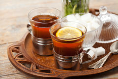 Black tea. Set of cups with black tea on tray stock image