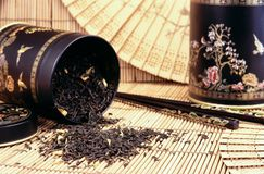 Black tea spilling out Stock Photo
