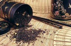 Black tea spilling out stock photos