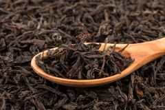 Black tea in a spoon Royalty Free Stock Images