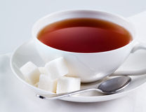 Black tea with sugar cubes Stock Photography
