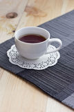 Black tea on the table. Black tea in a mug on a table in clear weather Stock Photo