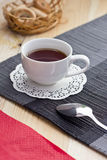 Black tea on the table. Black tea in a mug on a table in clear weather Royalty Free Stock Image