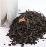 Black tea and tea bag Stock Images