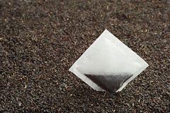 Black tea and tea bag Royalty Free Stock Images