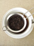 Black tea in tea strainer Stock Photo