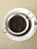 Black tea in tea strainer Stock Photo
