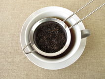 Black tea in tea strainer Stock Photos