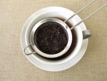 Black tea in tea strainer Stock Photos