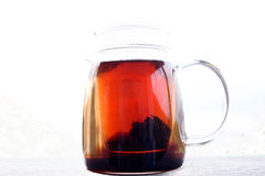Black tea and teapot Royalty Free Stock Images