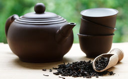 Black tea, teapot and cups on the table Stock Images