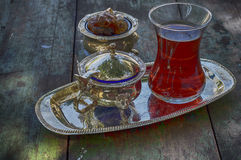 Black tea in a traditional Turkish cup on a silver platter Royalty Free Stock Image