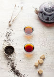 Black tea in a transparent teapot and cups Royalty Free Stock Photography