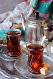 Black tea Turkish cups. With sweetness Stock Photography