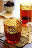 Black tea. Two glasses of black tea Royalty Free Stock Photo