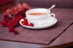 Black tea in a white cup Stock Images