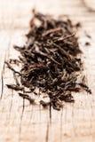 Black tea on wooden background macro Royalty Free Stock Image