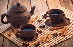 Black tea wooden table, black tea clay cups royalty free stock images