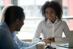Black team leader having conversation with colleagues during meeting. African millennial businesswoman team leader having conversation with colleagues company stock image