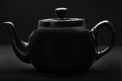 Black teapot over black background Stock Images
