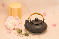 Black teapot,  tea and peony Royalty Free Stock Images