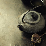 Black Teapot on vintage background Stock Photos