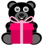 A black teddy bear happy to receive a gift royalty free stock photos