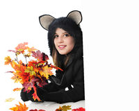 Black Teen Cat Peeking Behind a Sign Royalty Free Stock Photos