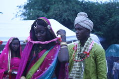 Black teen in Indian dress. Students displays, mimicking couple Indonesia culture. A mature man and lady ready to married ushered at the event of marriage Royalty Free Stock Photos