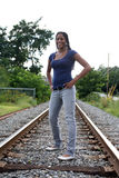 Black teen standing on a railroad bed Royalty Free Stock Images