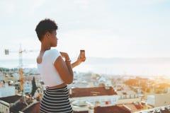 Black teenage female taking selfie on the roof Stock Photo
