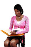 Black Teenage Girl Posed. Young Black Teen Female Posing With Family Bible Royalty Free Stock Photography
