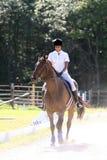 Black Teenage Girl Riding Horse Stock Photo