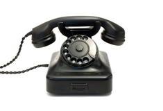 Black telephone. Retro black telephone isolated on white Stock Photography