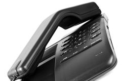 Black telephone. In vertical position on white background Royalty Free Stock Photo