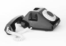 Black telephone. Vintage black telephone on  white background Stock Photography