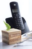 Black telephone with 3d puzzle and network cable Stock Photography