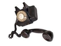 Black telephone five. Vintage black telephone on white background Stock Photography