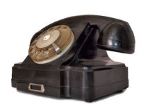 Black telephone four. Vintage black telephone on white background Royalty Free Stock Photography