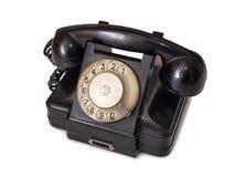 Black telephone one. Vintage black telephone on white background Royalty Free Stock Photos