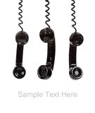 A black telephone receiver on white with copy Royalty Free Stock Photos