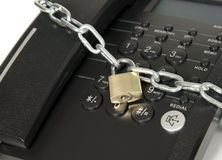 Black telephone is secured with lock Royalty Free Stock Image