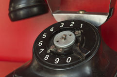 Black telephone set in red phone box Royalty Free Stock Photo