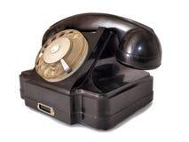 Black telephone six. Vintage black telephone on white background Stock Images