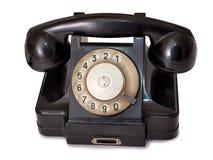 Black telephone two. Vintage black telephone on white background Royalty Free Stock Image