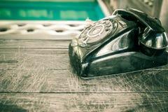 Black telephone in vintage style. Old black telephone in vintage style Royalty Free Stock Photos