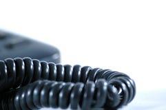 Black telephone on the white background. Photo telephone on the white background Stock Image