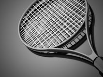 Black tennis racket rendered on dark Stock Photography