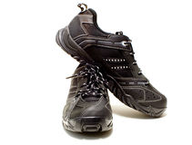 Black tennis shoes. A pair of black tennis shoes royalty free stock photos
