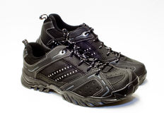 Black tennis shoes. A pair of black tennis shoes for exercising royalty free stock images